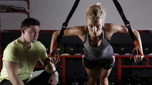 Personal trainer working with their client