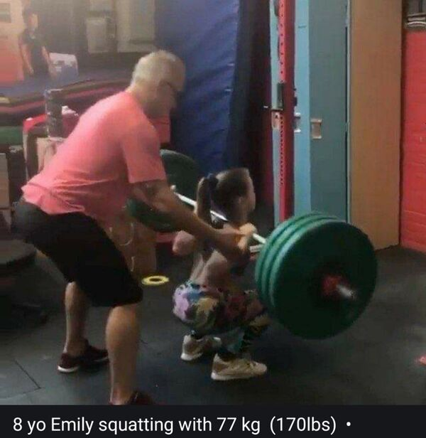 a child lifting heavy weights